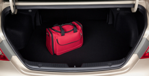 car trunk with red bag